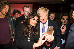 © London News Pictures. 15/04/2016. Manchester, UK. Mayor of London BORIS JOHNSON poses for a selfie with a fan after talking at a Vote Leave campaign event in Manchester, ahead of a referendum on Britain's membership of the EU on June 23rd, 2016. . . Photo credit: Ben Cawthra/LNP