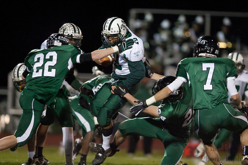 Pemberton High School's Ahmir Grahm (32) gets brought down by West Deptford High School's Ryan Flaherty (24) and Herb Snyder (22)during a Group 2 first round playoff game at West Deptford High School on Friday November 11, 2011. (photo / Mat Boyle)