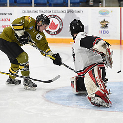 TRENTON, ON  - MAY 4,  2017: Canadian Junior Hockey League, Central Canadian Jr. &quot;A&quot; Championship. The Dudley Hewitt Cup. Game 5 between Powassan Voodoos and the Georgetown Raiders. Parker Bowman #17 of the Powassan Voodoos scores a goal on Josh Astorino #1 of the Georgetown Raiders during the second period.<br /> (Photo by Andy Corneau / OJHL Images)