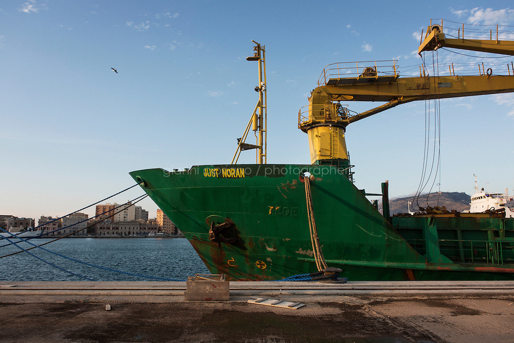TRAPANI, ITALY - 7 JUNE 2016: Cargo ship Just Noran, seized by the Guardia di Finanza (Financial Police) in June 2014 as it was carrying 28 tons of hashish from Morocco to Libya, is docked here in the harbor in Trapani, Italy, on June 7th 2016.<br /> <br /> Between January 2014 e December 2015 more than 120 tons of hashish, carried on fishing boats or cargo ships from Morocco to Libya, were seized in the Strait of Sicily by Italy&rsquo;s Guardia di Finanza (Financial Police) thanks to an international police investigation named &ldquo;Operazione Libeccio&rdquo;, carried out by the GICO (Gruppo Investigativo Criminalit&agrave; Organizzata, Organised Crime Investigation Group), a unit of the tax police of Palermo under the supervision of the DDA (Direzione Distrettuale Antimafia) of Palermo.<br /> <br /> &ldquo;What is happening in Libya is same historical occurrence that happened years ago in Afghanistan. Such as the Talibans who financed their terroristic activities with heroin trafficking for the purchase of weapons, the Caliphate is proposing the same terroristic strategy by purchasing and commercialising hashish in order to purchase weapons used in their war&rdquo; Sergio Barbera, Deputy General Prosecutor of Palermo, said.