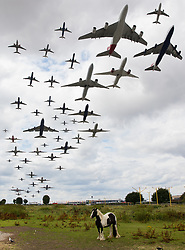 © Licensed to London News Pictures. 21/07/2017. London, UK. All 49 aircraft taking off from Heathrow's southern runway in one hour from 13:40 to 14:40 hours are shown together in this combined image taken on Friday the 21st July - which was the busiest day in UK air traffic history with 8,800 flights leaving or entering UK airspace. Photo credit: Peter Macdiarmid/LNP