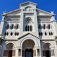 Saint Nicholas Cathedral Front Fa&ccedil;ade in Monte Carlo, Monaco  <br /> The first Saint Nicholas church to be built on &ldquo;The Rock&rdquo; was in 1252. It was replaced by the Cath&eacute;drale de Monaco in 1875. It is called Saint Nicholas Cathedral. Officially, the name of this Roman Catholic church is the Cathedral of Our Lady of the Immaculate Conception. A secondary patron saint is Saint Beno&icirc;t. Benedict of Nursia lived in the 6th century and is also a patron saint of Europe and students. Their statues can be seen on either side of the cathedral&rsquo;s entrance.