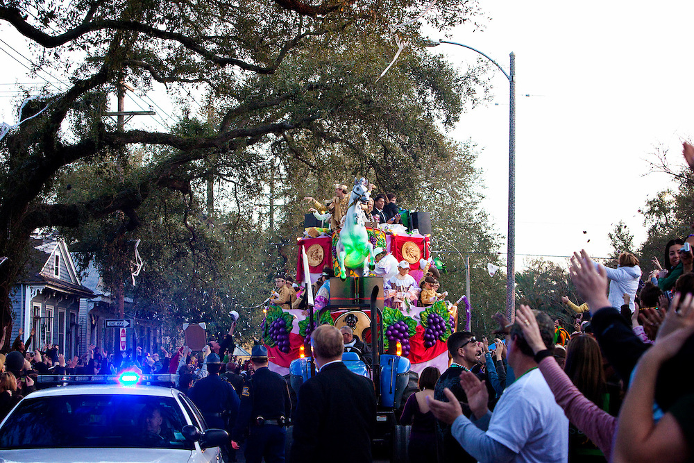 Super Bowl MVP and New Orleans Saints Quarterback Drew Brees #9 as King of Bacchus throws beads and doubloons to the fans in the Krewe of Bacchus parade as they get roll up Napoleon Avenue in New Orleans, Louisiana. USA.