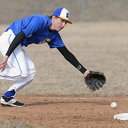 Staff photos by Tom Kelly IV<br /> Springfield shortstop Brandon DiChiaccio (9) comes up short attempting to field this ground ball during the Springfield at Cardinal O'Hara baseball game on Tuesday afternoon, March 24, 2015.