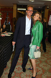 VISCOUNT BENOIT DE BIOLLEY and KIMBERLEY DU ROS at '4 Inches' a project 'For Women about Women By Women' - A photographic Auction in aid of the Elton John Aids Foundation hosted by Tamara Mellon President of Jimmy Choo and Arnaud Bamberger MD of Cartier UK at Christie's, 8 King Street, London W1 on 25th May 2005.<br />