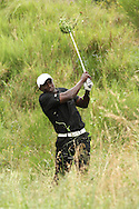 Dwight Yorke plays out of the rough on the 18th during round 2 of the Gary Player Invitational presented by Coca Cola and held at Fancourt in George on the 21st November 2010..Photo by Shaun Roy/SPORTZPICS