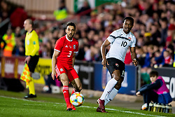 WREXHAM, WALES - Wednesday, March 20, 2019: Wales' Neil Taylor and Trinidad and Tobago's Levi Garcia during an international friendly match between Wales and Trinidad and Tobago at the Racecourse Ground. (Pic by Paul Greenwood/Propaganda)