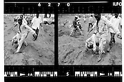 Workers carrying bodies to the massgraves in Goma,Zaire. 1994 -<br /> <br /> The sun had set over the rwandan capital Kigali as president Juvenal Habyarimana's plane approached the city's airport on 6.april 1994.Suddenly, out of the darkness, a rocket hit the plane and sent it crashing to the ground, killing everyone on board.over the next three month's, more than 800.000 rwandans would be murdered, many cut down with machetes, killed by neighbours and countrymen, in a ferocious ethnic genocide that was all but ignored by the international world.