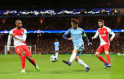 David Silva of Manchester City crosses under pressure from Djibril Sidibe of Monaco - Mandatory by-line: Matt McNulty/JMP - 21/02/2017 - FOOTBALL - Etihad Stadium - Manchester, England - Manchester City v AS Monaco - UEFA Champions League - Round of 16 First Leg