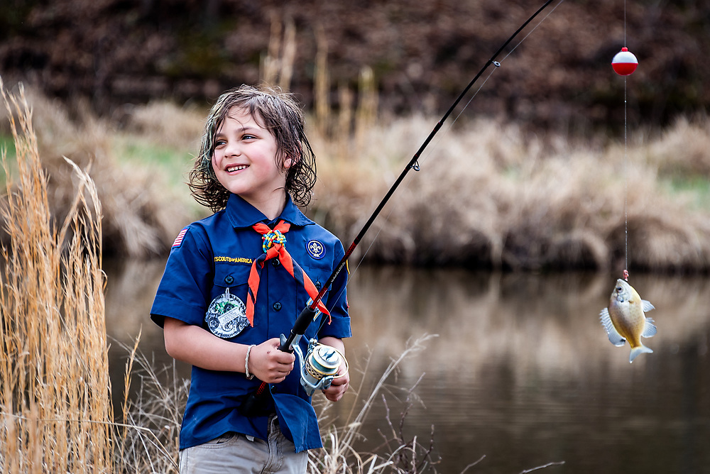 Cub Scout fishing at Woodfield Scout Preservation in Asheboro, NC.