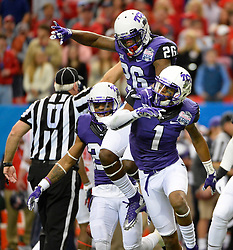 TCU Horned Frogs safety Derrick Kindred (26) and wide receiver Emanuel Porter (1) celebrate during the first half of the Ole Miss vs. TCU Chick-fil-A Peach Bowl football game at the Georgia Dome on December 31, 2014. David Tulis / Abell Images for the Chick-fil-A Bowl