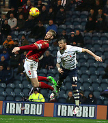 Matt Mills and Joe Garner battle during the Sky Bet Championship match between Preston North End and Nottingham Forest at Deepdale, Preston, England on 3 November 2015. Photo by Pete Burns.