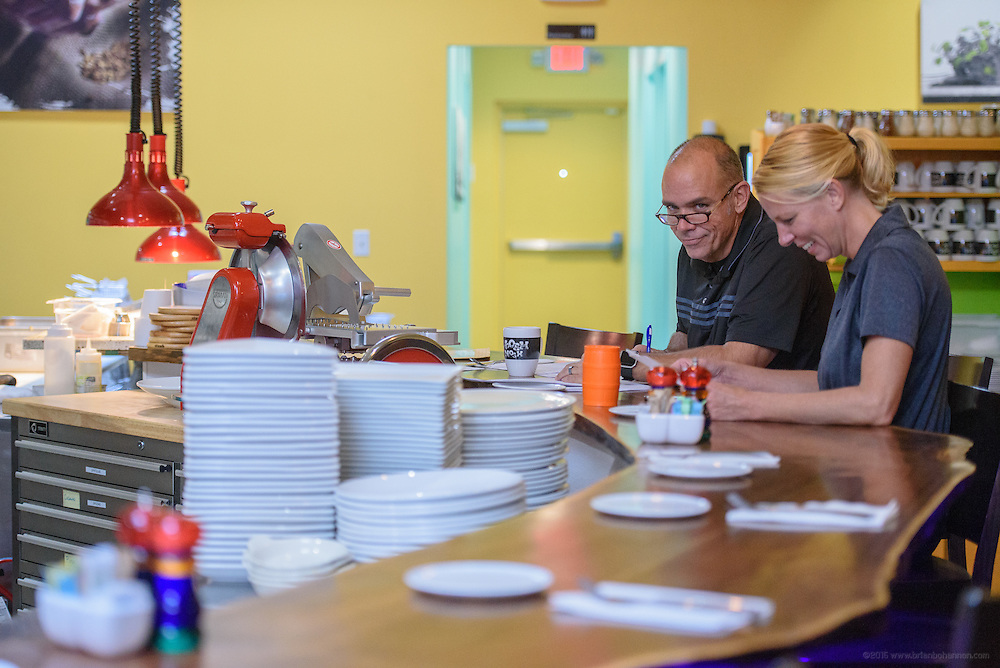Bryan Kidd, general manager, and Laura Andres bartender, talk over paperwork at Noosh Nosh. Photos at Anoosh Shariat's anoosh Bistro and Noosh Nosh Monday, Aug. 15, 2016. (Photo by Brian Bohannon)
