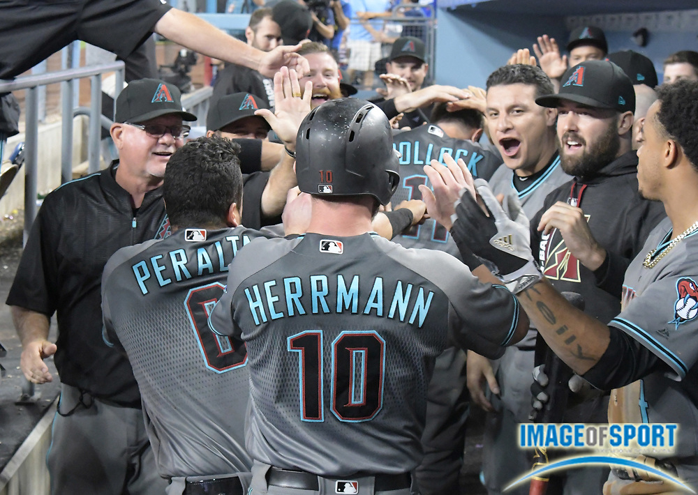 Sep 5, 2017; Los Angeles, CA, USA; Arizona Diamondbacks catcher Chris Herrmann (10) celebrates with teammates after scoring in the 10th inning against the Los Angeles Dodgers during a MLB baseball game at Dodger Stadium. The Diamondbacks defeated the Dodgers 3-1 in 10 innings.