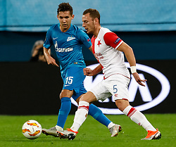 October 4, 2018 - Saint Petersburg, Russia - Elmir Nabiullin (L) of FC Zenit Saint Petersburg and Vladimir Coufal of SK Slavia Prague vie for the ball during the Group C match of the UEFA Europa League between FC Zenit Saint Petersburg and SK Sparta Prague at Saint Petersburg Stadium on October 4, 2018 in Saint Petersburg, Russia. (Credit Image: © Mike Kireev/NurPhoto/ZUMA Press)