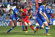 Andy Cannon is challenged by Ousmane Fane during the EFL Sky Bet League 1 match between Oldham Athletic and Rochdale at Boundary Park, Oldham, England on 22 April 2017. Photo by Daniel Youngs.