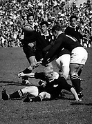 Mac Herewini tries to grasp the ball in action from the fourth test between NZ and SA at Eden Park, 1965. Behind Herewini are John Collins and Ron Rangi. On the ground is Red Conway.<br /> Photosport