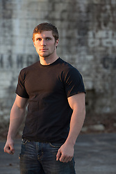 muscular man in a black tee shirt