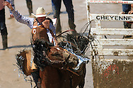 Saddle Bronc Rider and CFD Champion Taos Muncy wins it all with his ride on JK's Bags of Tricks, Championship Sunday, 29 July 2007, Cheyenne Frontier Days