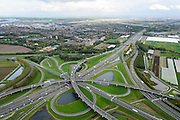 Nederland, Zuid-Holland, Gemeente Rotterdam, 23-10-2013; Knooppunt Ridderkerk, verkeersknooppunt A15 en A16, bijgenaamd 'Ridderster'. Foto in ZZO-richting (naar Breda). Klaverblad met opritten, afritten en fly-overs. De waterpartijen zijn kunstmatige aangelegd en kunnen dienen als bluswater ingeval van calamiteiten.<br /> Ridderkerk junction, junction A15 / A16, nicknamed 'Ridder star'. Cloverleaf type junction, with ramps, exit ramps and flyovers. The ponds are man-made, the water can be used for firefighting in case of emergencies.<br /> luchtfoto (toeslag op standard tarieven);<br /> aerial photo (additional fee required);<br /> copyright foto/photo Siebe Swart