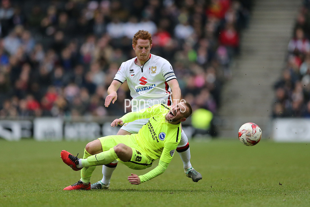 Milton Keynes Dons defender Dean Lewington (3) fouls Brighton striker Jiri Skalak (38) during the Sky Bet Championship match between Milton Keynes Dons and Brighton and Hove Albion at stadium:mk, Milton Keynes, England on 19 March 2016.