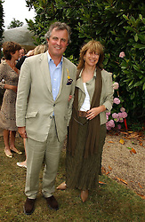 "VISCOUNT & VISCOUNTESS ASTOR at the Goodwood Festival of Speed on 9th July 2006.  Cartier sponsored the ""Style Et Luxe' for vintage cars on the final day of this annual event at Goodwood House, West Sussex and hosted a lunch.<br />