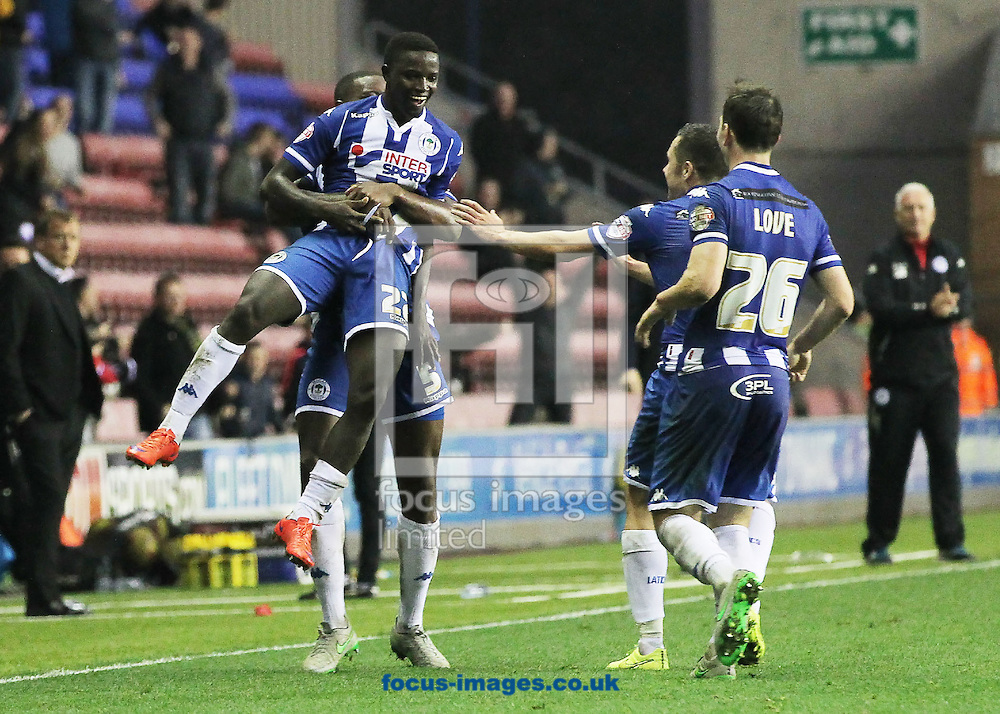 Francisco Junior of Wigan Athletic celebrates with his team mates after  scoring the winning goal against Swindon Town very late into injury time, during the Sky Bet League 1 match at the DW Stadium, Wigan.<br /> Picture by Michael Sedgwick/Focus Images Ltd +44 7900 363072<br /> 31/10/2015