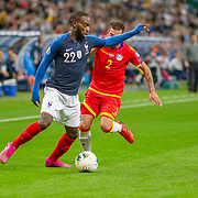 PARIS, FRANCE - September 10:  Jonathan Ikone #22 of France defended by Cristian Martínez #2 of Andorra during the France V Andorra, UEFA European Championship 2020 Qualifying match at Stade de France on September 10th 2019 in Paris, France (Photo by Tim Clayton/Corbis via Getty Images)