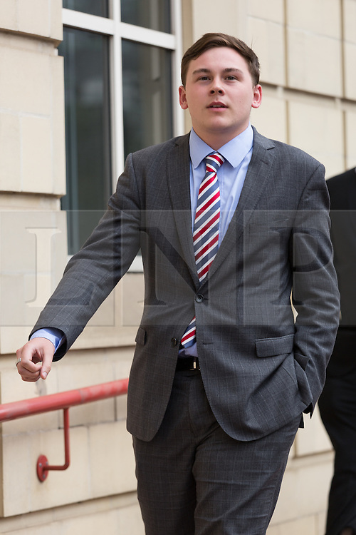 © Licensed to London News Pictures. 15/07/2014. London, UK. Jordan Munday leaves Thames Magistrates Court in London over alleged racist behaviour on a Paris Metro train in February. He is one of five Chelsea fans facing a Football Banning Order because of alleged racist behaviour on the Paris Metro train. Photo credit : Vickie Flores/LNP