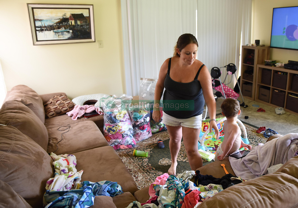 September 5, 2017 - Key West, FL, United States - Amber Peery and her young son pile clothing to pack as they prepare to evacuate from Hurricane Irma September 5, 2017 in Key West, Florida. Monroe County officials have issued a mandatory evacuation order across the Florida Keys in preparation for landfall of the dangerous storm. (Credit Image: © Cody R. Babin/Planet Pix via ZUMA Wire)