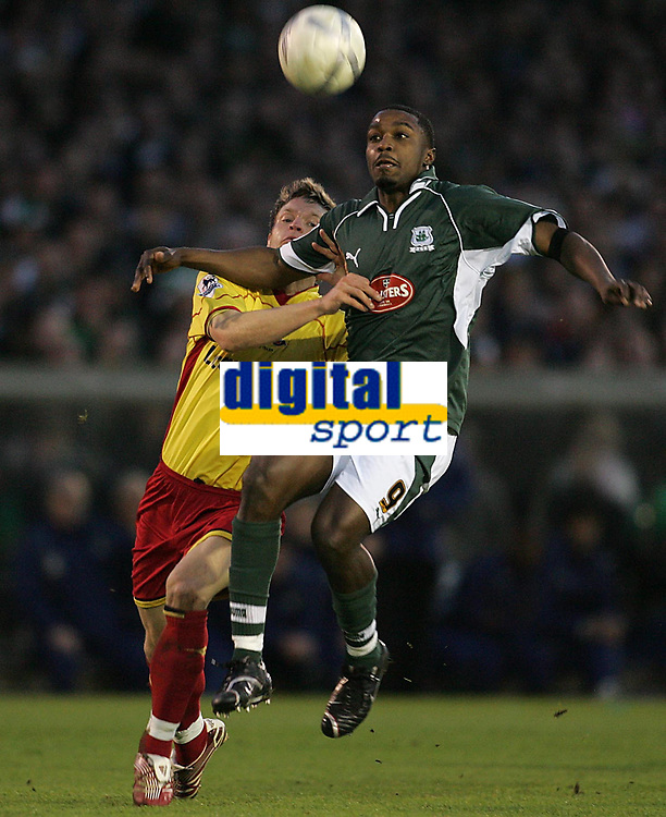 Photo: Lee Earle.<br /> Plymouth Argyle v Watford. The FA Cup. 11/03/2007.Watford's Jay DeMerit (L) holds back Sylvan Ebanks-Blake.