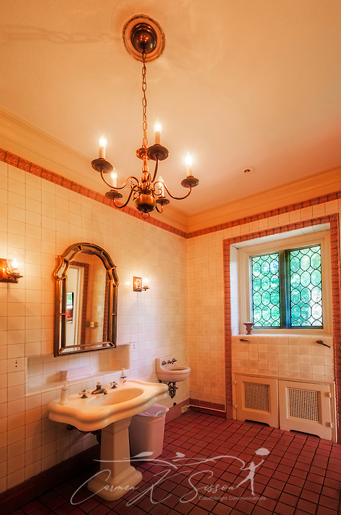 A chandelier hangs in a bathroom at Callanwolde Fine Arts Center, July 9, 2014. Callanwolde is housed within a 27,000 square foot Gothic-Tudor Revival mansion and nestled on 12 acres in Atlanta, Georgia. The house, built in 1920, was the home of Charles Howard Candler, son of the founder of the Coca-Cola Company. The house was designed by architect Henry Hornbostel. Today, Callanwolde operates as a non-profit organization devoted to teaching and promoting the visual, literary and performing arts. (Photo by Carmen K. Sisson/Cloudybright)