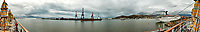 """Panorama of the Ensenada harbor in Mexico on a grey and raining day from the deck of the MV World Odyssey. The other cruse ship is the Carnival Imagination. Once all of the students, faculty, staff, and life long learners were aboard we would be ready to begin the 102 day """"round the world"""" Semester at Sea Spring 2016 Voyage. Composite of eight images taken with a Nikon N1 V3 camera and 10-30 mm lens (ISO 200, 10 mm, f/11, 1/250 sec). Panorama stitched using AutoPano Giga Pro."""