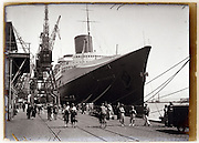 the luxury passenger ocean liner SS Normandie moored in harbor 1930s