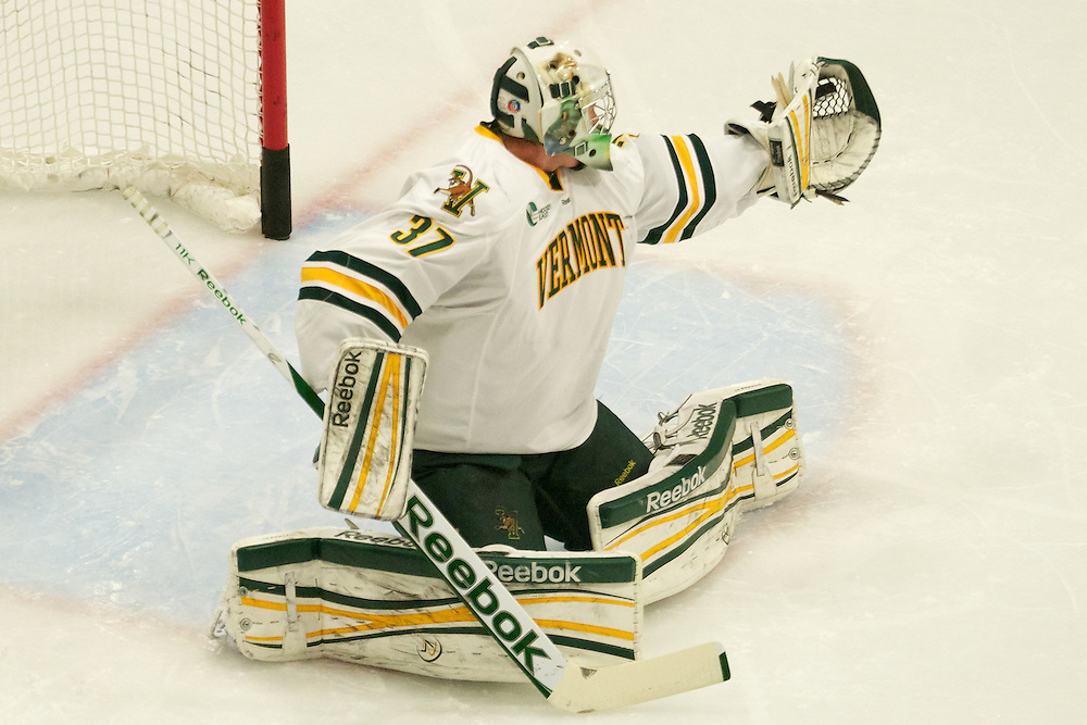 Catamount goalie Brody Hoffman (37) makes a glove save during the mens hockey game between the Providence Friars and the Vermont Catamounts at Gutterson Field House on Saturday night November 3, 2012 in Burlington, Vermont.