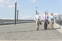 Rear view of businesspeople walking on bridge
