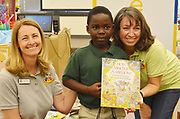 Books Between Kids gives away their one-millionth book to Piney Point ES second-grader Justin Ikwuagwu, who is from Nigeria. Justin is show here with Books Between Kids founders Sandra Ahlhorn and Amy Barnes.