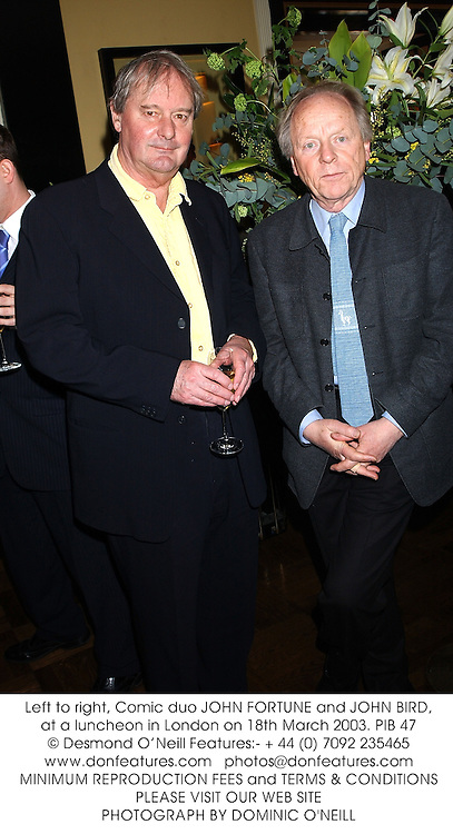 Left to right, Comic duo JOHN FORTUNE and JOHN BIRD, at a luncheon in London on 18th March 2003.PIB 47
