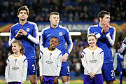 A smiling mascot with Chelsea FC defender Andreas Christensen (27), Chelsea FC midfielder Ross Barkley (8) and Chelsea FC defender Marcos Alonso (3) before the Europa League round of 16, leg 1 of 2 match between Chelsea and Dynamo Kiev at Stamford Bridge, London, England on 7 March 2019.