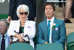 &copy; Licensed to London News Pictures. 02/07/2018. London, UK. Sir Cliff Richard watches centre court tennis in the sweltering heat at the Wimbledon Tennis Championships 2018 <br /> . Photo credit: Ray Tang/LNP
