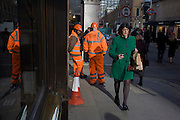 Construction workers war high-vis suits near the capital's mainline station in Liverpool Street, in the City of London.