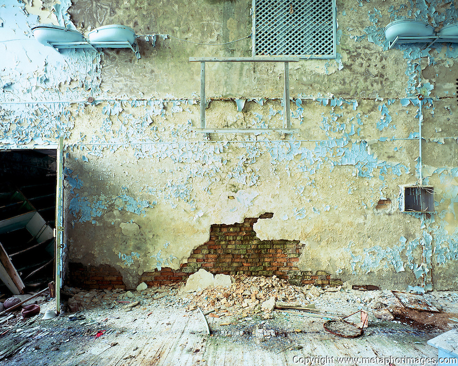 Gymnasium II, 2003, Ukraine.<br /> The city of Pripyat lies abandoned next to the Chernobyl nuclear power station. In April 26, 1986, the worst nuclear accident the world has seen contaminated large areas of Europe with radioactive fallout. Vast areas of land around the reactor make up the Chernobyl Exclusion Zone. The area is now an increasingly popular tourist destination. <br /> <br /> <br /> Wastelands is a journey into abandoned and transient spaces in Australia and Europe. Over a number of years I&rsquo;ve travelled with a large format camera to record some of the unusual ways that buildings decline, and the more unusual ways that space is reordered. <br /> <br /> A common practice is to transform abandoned industrial sites into modern centres of consumption. Old industrial centres often find new life as shopping centres. But family fun parks in abandoned nuclear power stations and the prospect of a European wilderness in Chernobyl reveal that landscape is never a finished project, nor what we always expect.<br /> <br /> Large format photography has had a long association with architecture and landscape. It expands detail and corrects perspective, often recording more than we can actually see, compelling us to look longer.