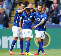 Leicester City's Riyad Mahrez celebrates with Leicester City's Marcin Wasilewski and Leicester City's Leonardo Ulloa - Photo mandatory by-line: Robbie Stephenson/JMP - Mobile: 07966 386802 - 09/05/2015 - SPORT - Football - Leicester - King Power Stadium - Leicester City v Southampton - Barclays Premier League