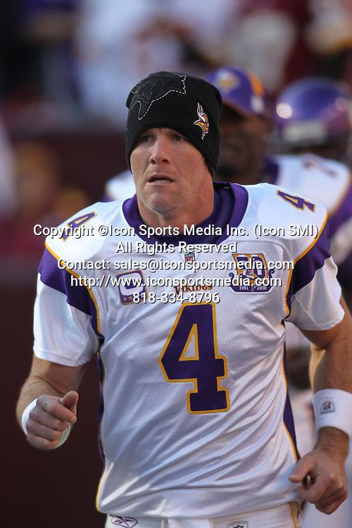 28 NOVEMBER 2010:  Minnesota Vikings quarterback Brett Favre runs onto field before game against the Washington Redskins.  The Vikings defeated the Redskins 17-13 at Fed Ex Field in Landover, Md.