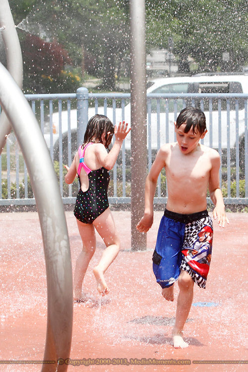 Lauren Taylor, 5 (left) and Bryce, 8 at Orchardly Park in Oakwood, Sunday, June 9, 2013.