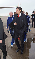 CARDIFF, WALES - Saturday, November 15, 2014: Wales' manager Chris Coleman and the squad arrive at Cardiff Airport for their flight to Brussels ahead of the UEFA Euro 2016 Qualifying Group B game against Belgium. (Pic by David Rawcliffe/Propaganda)