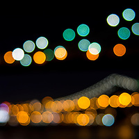 Abstract images of Manhattan skyline lights at night from Brooklyn Bridge Park in New York City
