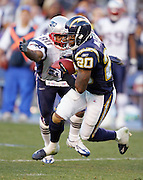SAN DIEGO - JANUARY 14:  Free safety Marlon McCree #20 of the San Diego Chargers intercepts and fumbles a fourth down pass intended for wide receiver Troy Brown #80 of the New England Patriots at the AFC Divisional Playoff Game held on January 14, 2007 at Qualcomm Stadium in San Diego, California. The Patriots defeated the Chargers 24-21. ©Paul Anthony Spinelli *** Local Caption *** Marlon McCree;Troy Brown