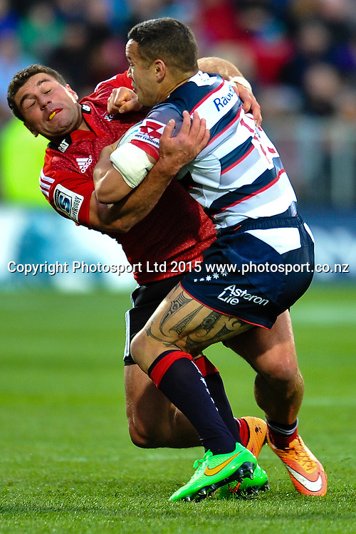 Kieron Fonotia of the Crusaders and Tamati Ellison of the Rebels in the Super Rugby match, Crusaders v Rebels at AMI Stadium, Christchurch, New Zealand 13 February 2015. Photo:John Davidson/www.photosport.co.nz