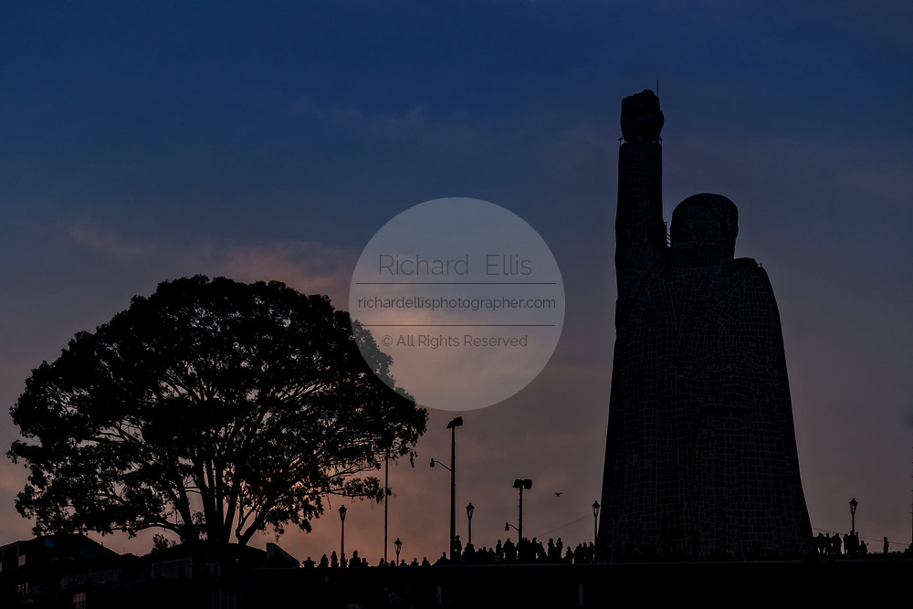 Sunset silhouettes the statue of Jose Morelos on the hilltop island of Janitzio in Lake Patzcuaro, Michoacan, Mexico.